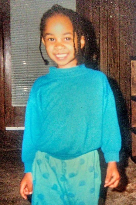 little girl wearing blue